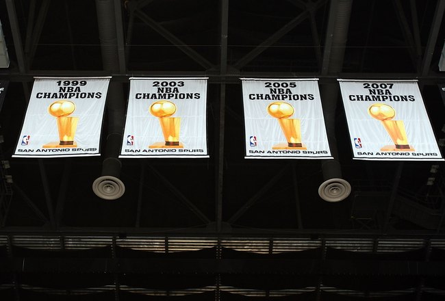 The Spurs four championship banners hang from the rafters at the AT&T Center in San Antonio, TX.(Photo: Ronald Martinez/Getty Images)