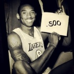 "An altered photo of Kobe Bryant poking fun at the Lakers subpar record. This photo mimics the original picture of Wilt chamberlain holding his sign with ""100"" in recognition of his 100 point game."