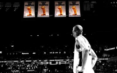 Tim Duncan admires his work as he stares at four banners hanging from the AT&T Center in San Antonio, TX.(Photo: Ryan Hurst)