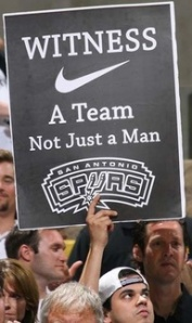 Spurs fan holds up sign similar to LeBron's trademark Witness slogan.(Photo: Alan Ruhd)